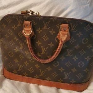 Luis Vuitton Alma bag